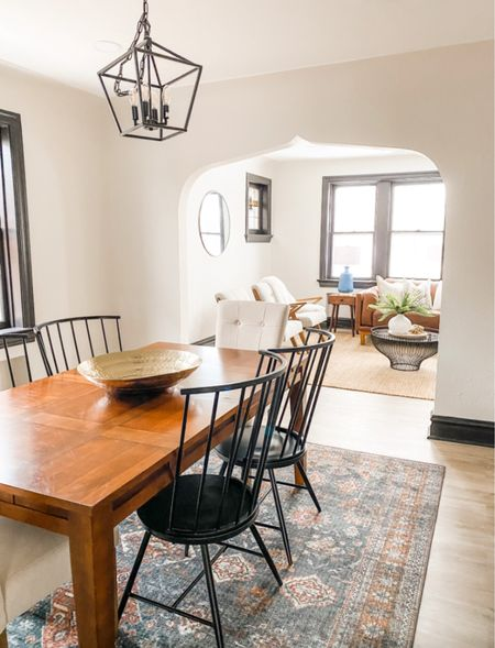 Beautiful dining room with wood table, black metal chairs and a black lantern chandelier.  Dining room decor, dining chairs, home decor, chandelier, lighting ideas, modern farmhouse dining room   #LTKhome