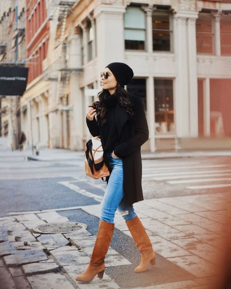Black coat with denim and knee high boots.   #LTKSeasonal #LTKstyletip