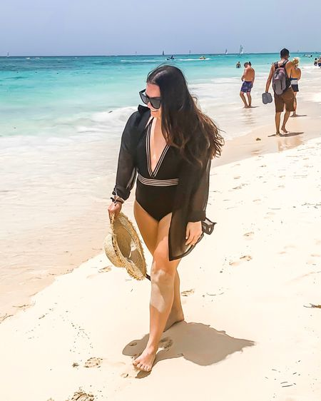 Black low cut one piece bathing suit with something navy Panama hat beach look http://liketk.it/2CUlw #liketkit @liketoknow.it
