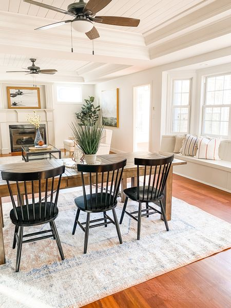 All the modern farmhouse feels in this dining room.  Windsor chairs, farmhouse dining table, dining room decor, black spindle chairs, modern farmhouse home, wood table, home decor  #LTKhome