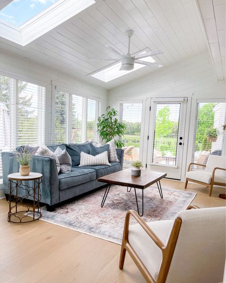 Sunroom refresh!   When we moved in, I was nearly 9 months pregnant and we'd just gutted our house to the studs.  I wanted everything clean, white, and bright.  So I basically avoided color 😅. Now that we've lived here for about a year and a half, we've been craving more color and to make our house even more homey.   So one of the rooms we've started in is one of our very favorites - our sun room.    We got a few new plants to add some earthiness and this beautiful new rug (that's also machine washable - bonus with kids and an old lady dog).  We refreshed the pillows (home goods) too and everything else is either linked or re-purposed from over the years.  Loving how it's come together in this favorite room of ours!  Swipe over for some before pics too for fun!   Direct links here: http://liketk.it/3feBc   Download the LIKEtoKNOW.it shopping app to shop this pic via screenshot // #liketkit // @liketoknow.it #LTKhome