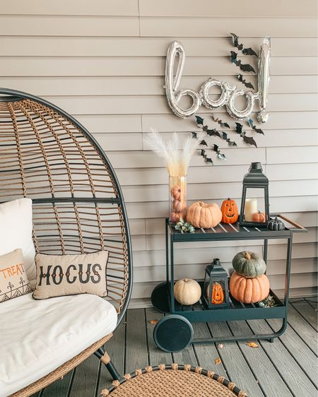 With a spooky BOO! 👻 Halloween's the best! #halloweenhome Wanted to do something fun this year so I decided to decorate the back patio bar cart with fall and Halloween decor. Linking everything in the @shop.LTK app for easy shopping! These bats and balloon are such an easy last minute Halloween decoration idea 🎃 #halloween #boo #liketkit #halloweendecor #spooky #barcart #ltkhome #ltkholiday #falldecor #bats #halloweenspirit #batty #halloweendecorations #barcartstyling   #patio #halloweenparty #fallinspo #farmhousestyle #halloweenballoons  #targethome #halloweenhomedecor #ltkseasonal #halloweenpartyideas #halloweentime #pumpkindecor #fauxpumpkins #hocuspocus