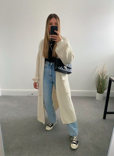 10 ways to wear a maxi cardigan 👉🏼   The perfect transitional layer for those 'in between' outfits. I wasn't much of a cardigan wearer until this came along and now it's all I want to wear.  5. Straight jeans and converse     #LTKunder50 #LTKeurope #LTKstyletip