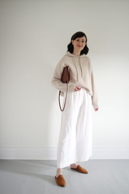 I love mixing materials like cashmere and linen as the seasons transition. This is a recent favourite.   Hoodie & Suede Mules - Jenni Kayne - Use LEE15 for 15% Off anytime Linen pants - Old Bag - A.P.C.