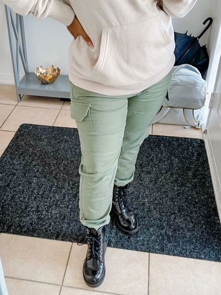 Combat boots for the season #combatboots #sweater #beigesweater #olivegreenpants #falloutfit  #LTKSeasonal #LTKshoecrush #LTKcurves
