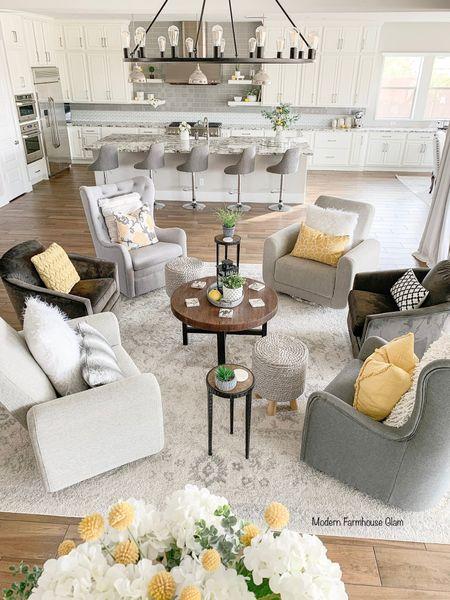 Our conversation area furniture, family room furniture, living room furniture, swivel glider chair, coffee table, accent table, wagon wheel lighting fixture chandelier, pillows, yellow, shag, Pottery Barn, Wayfare, Amazon, Walmart, home decor, a Modern Farmhouse Glam.   @liketoknow.it #liketkit http://liketk.it/3fQog #LTKhome #LTKsalealert @liketoknow.it.home Download the LIKEtoKNOW.it shopping app to shop this pic via screenshot