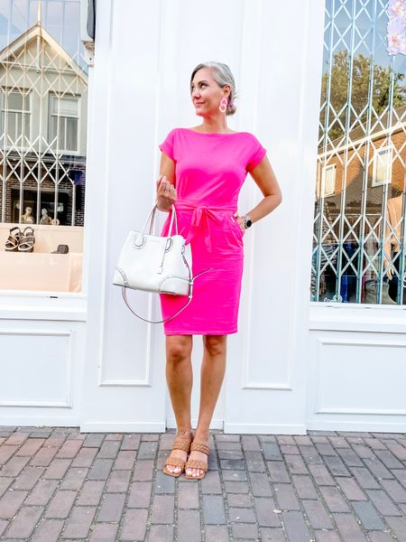 Figured I'd keep the pink streak going with this lovely bright number 💗  It's made out of t-shirt material (soft and comfy) and has pockets! It's a universal size with great length and I would say it fits up to an L/XL.   Shoes fit tts and are perfect for wider feet. Handbag is preloaded Michael Kors through Vinted.   So tell me, who else worked today because I have the feeling everybody is on holiday?     #LTKunder50 #LTKworkwear #LTKeurope