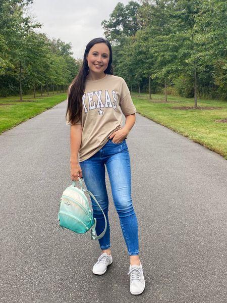 Casual walk outfit- comfy jeans, oversized tee shirt, kate spade backpack, comfy sneakers   #LTKfit #LTKsalealert #LTKtravel