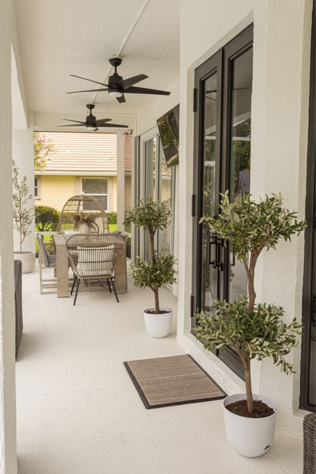 USE CODE CHEERS 20 % off your next Ruggable Rug!   Love their doormats to the max! Super easy to clean and maintain. Just wash as needed with a hose.  Outdoors, doormat, ruggable, outdoor rugs, olive tree, dining table, ceiling fans, egg chair  #LTKsalealert #LTKhome