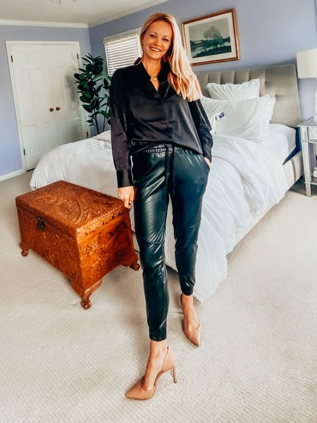 Work appropriate joggers. Wear faux leather joggers to work. Add a satin button down and heels. Love this all-black look for fall. This top runs TTS. It has stretch and is under $50. It's Amazon the Drop and I have it in one other color. Love this top. The joggers are stretchy, comfortable and cute. Size up.   #LTKstyletip #LTKworkwear #LTKunder50