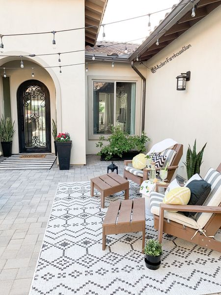 Our courtyard patio furniture, outdoor rug, Adirondack chairs, tall planter, planting pot, window flower box, outdoor lighting, bistro lighting, string lights, outdoor furniture, backyard, entryway, summer, Modern Farmhouse Glam   http://liketk.it/3hl9E #liketkit @liketoknow.it #LTKhome #LTKsalealert #LTKDay @liketoknow.it.home You can instantly shop my looks by following me on the LIKEtoKNOW.it shopping app