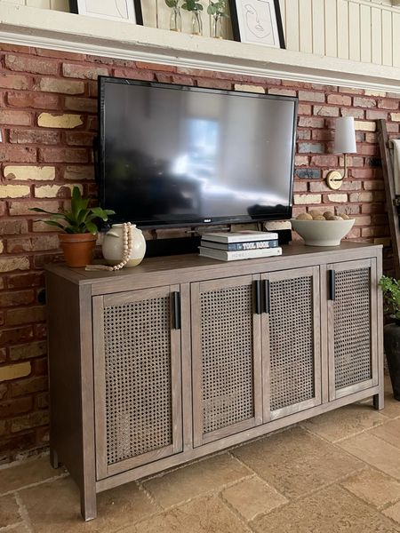 I am totally obsessed with my new cane front entertainment cabinet. It is beautiful and was so easy to put together.    #LTKSeasonal #LTKhome #LTKfamily