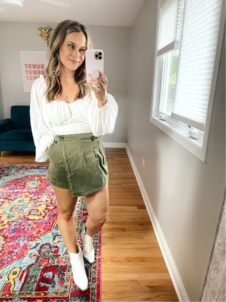 Weekend outfit ideas! This skort is free people but it's under $30! These white booties also come in black and are under $40 and this long sleeve cropped top is an amazon find!  #LTKshoecrush #LTKunder50 #LTKstyletip