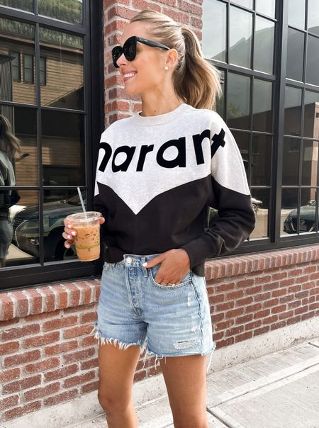 Wore this Isabel Marant Étoile sweatshirt (size 34) for walks to our morning coffee in telluride, paired with AGOLDE denim shorts & birks. Use code 10AMYFF for a discount on your first order now through October 12, 2021 #falloutfit #tellurideoutfit #farfetch #fallfashion #sweatshirt  #LTKtravel #LTKstyletip #LTKsalealert