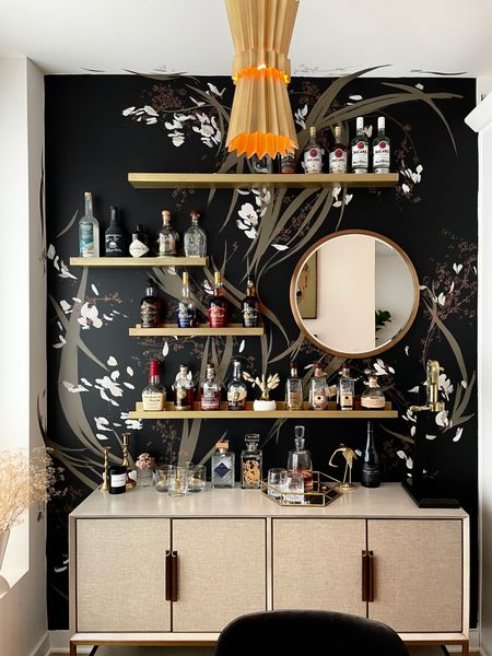 Moody dreamy bar, complete with a feature accent wall, sideboard, gold shelves, and plenty of booze!   #LTKhome #LTKDay #LTKsalealert