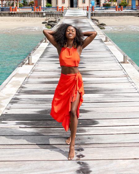 http://liketk.it/31CjO #liketkit @liketoknow.it #LTKswim #LTKtravel I love this orange skirt and top combo. This is a regular tank top that I tied to look cropped