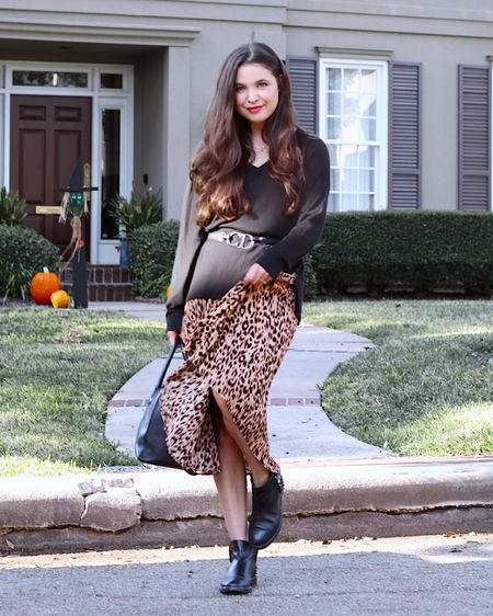 How to wear a black sweater a million different ways lol coming soon through my feed Lol We all have one in our closet and I have to say, this cozy sweater top has been on repeat for me  🖤  Love a good animal print+adding a festive feel before and after the holiday weekend! Seriously loving this pleated skirt (A consignment style up for grabs)  🎃🎃🎃 Sharing a few festive looks/Halloween costume starter ideas over at @shopgetthelook_ stories (Also saving in highlights) 💀  •Outfit Available to Shop 🏷 @shopgetthelook_ •Hair/Product Favs Linked @liketoknow.it http://liketk.it/2ZL90 #liketkit