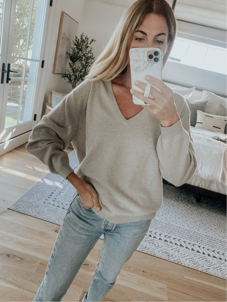 J. Crew cashmere v neck sweater paired with Levi's jeans