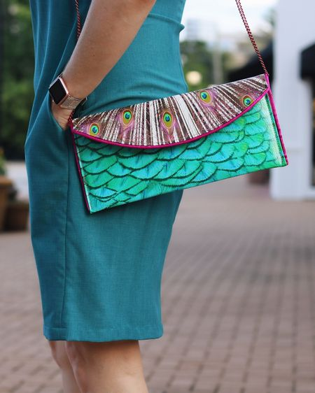 I had to do this thing called work today and that is a jarring reality after vacation! Anyone else feel that gut check???? Ahhhh The days gets better though when your #pursedaythursday has some feather action. This is one of my fav bags for summer and I linked this whole look 👉 http://liketk.it/2wJrf or Screenshot this pic to get shoppable product details with the LIKEtoKNOW.it app @liketoknow.it #liketkit #LTKcurves #LTKitbag #LTKunder100