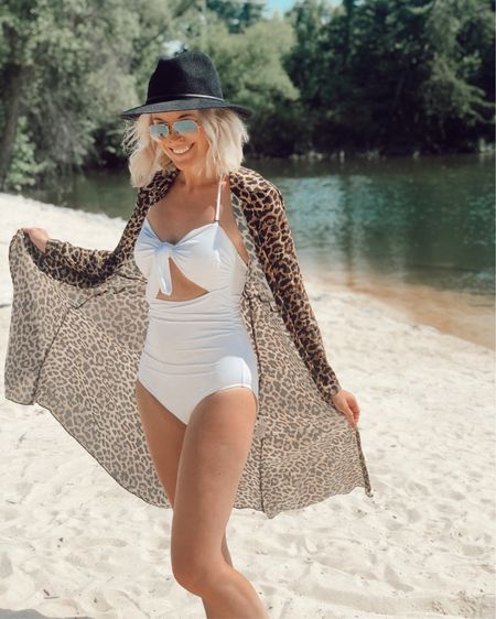 White tie-front one-piece swimsuit: under $20, runs TTS, removable straps 👍🏻 Leopard print kimono cover up 🐆 Sun hat comes in black and ivory 👒 http://liketk.it/2D9RD @liketoknow.it #liketkit #LTKswim #LTKunder50 #LTKsummer, swimwear, vacation, beach, neutrals, animal print, Amazon, glam