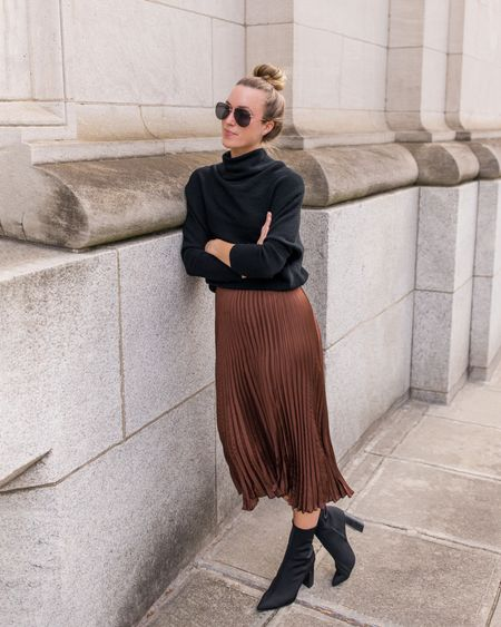Fall Skirt Outfit, Black Sweater, Pleated Skirt  Size S in sweater, S in skirt (if sold out in this color and size, three similar linked). Booties are old Steve Madden. Similar pair linked tat own in taupe—they run TTS.  #sweaters #fallskirtoutfits #bananarepublic
