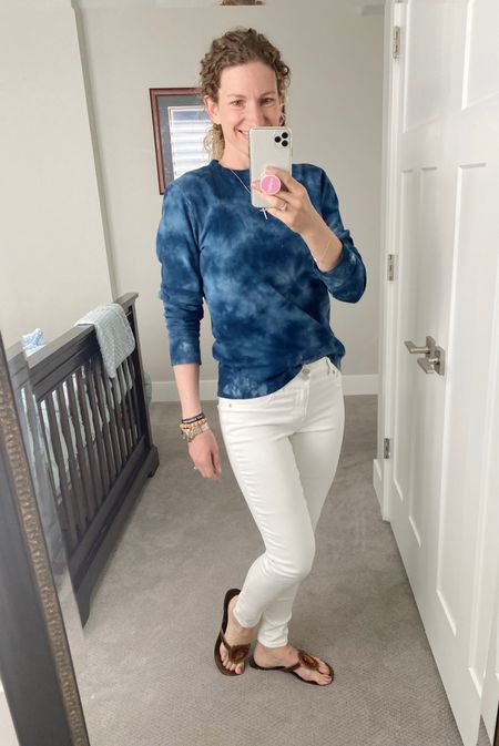 Spring outfit idea. White jeans jeggings. These are small / regular / double button from maurices. Love this fit! They don't fall down! Added others similar styles!  Classic sweatshirt. Fancy flip flop sandals. Fancy big watch & bracelet.   #LTKunder100 #LTKSeasonal #LTKunder50