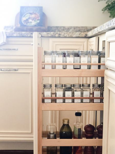 Spice Jar Organization  Streamline your spice cabinet for a clean and well organized look with matching labels that are easy to read    Spice cabinet   kitchen organization   diy organization   pantry organization   apothecary jars   kitchen   glass spice jars   spice jar labels  #LTKsalealert #LTKhome #LTKstyletip
