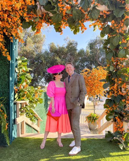 Wearing a pink and orange colorblock dress, J Crew clutch and pink earrings at the Veuve Clicquot Polo Classic. Bob is in a double breasted linen plaid suit and white sneakers   #LTKmens #LTKsalealert #LTKstyletip