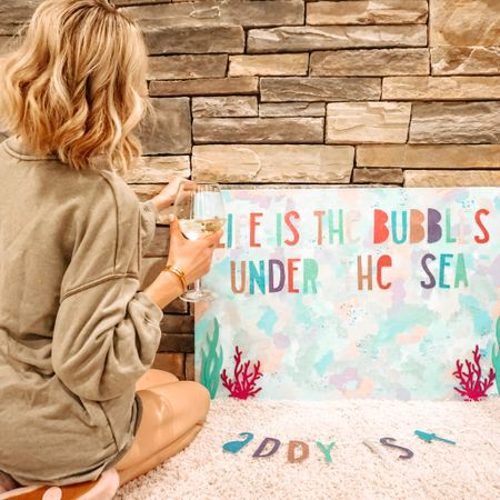 Speaking of bubbles - nothing gets the festive juices flowing like $6 Trader Joe's champagne. If those juices are fermented grapes. IF YOU FEEL ME 🥂  I DIY'd this backdrop for Addy's birthday party, and if you want a real giggle, head to my Stories to see what's on the back 😬🙃   Also linking up all the supplies AND the coziest ever loungewear set here: http://liketk.it/2JsMo #liketkit @liketoknow.it #LTKhome #LTKstyletip #LTKunder50