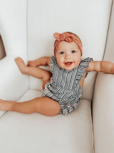 They do not have the same exact bow still, but they do have the same color! Such a cute combo!! The back on this romper is to DIE for. 😍  #LTKkids #LTKbaby #LTKstyletip