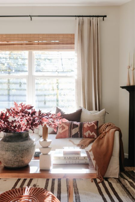 Fall living room vibes! Fall floral, large vase, linen curtains, coffee table