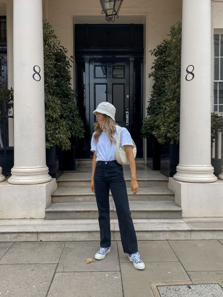 Keeping it casual with an oversized white T-shirt and a pair of weekday Rowe jeans! I've finished the look off with a bucket hat and a pair of leopard print converse     #LTKeurope
