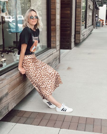Found this best seller leopard skirt restocked in a full size run (0-12) 🐆 Runs TTS and so easy to dress up or down! Love wearing it on mom duty with sneakers and a graphic t-shirt 🎸 Everything in this look is under $100 👏🏻👏🏻  http://liketk.it/2D2tJ @liketoknow.it #liketkit #LTKstyletip #LTKunder100 #LTKshoecrush #LTKsummer, animal print, midi skirt, silk skirt, adidas, casual, weekend