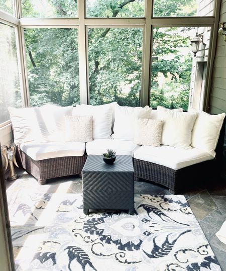 Current summer vibes mean lots of time spent in this gorgeous sunroom. A book, cup of hot coffee and my thoughts.   #LTKSeasonal #LTKfamily #LTKhome