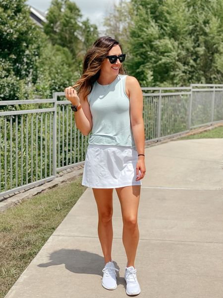 """I was never a """"weekend athleisure"""" gal… until I had a mobile baby 😜 heels and dresses just don't work well when you're literally chasing a kid across the house and rolling on the floor 🤷🏻♀️ Ive been loving this skort for running around on the weekends. It's got pockets (duh) and the built in shorts and higher waist make it crazy comfy. Grabbing it in black for fall 🙌🏽 Are you shopping for fall already? Here in Texas, fall means nothing until mid November 😉   #LTKunder100 #LTKfit #LTKSeasonal"""