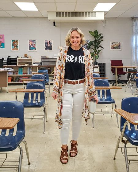 Casual everyday spring teacher outfit featuring a long floral kimono, white skinny jeans, a black AC/DC reading tee, and strappy block stacked heel sandals #teacher #read #reading #whitejeans #skinnyjeans #kimono #longkimono #floral #floralprint #strappysandals #spring #summer #Lifestyle #petite http://liketk.it/3dTTH @liketoknow.it #liketkit