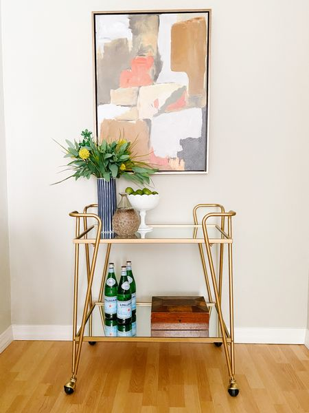 A pop of color with this abstract art print above the bar cart.  Abstract art, bar cart, bar cart style, home decor, accent furniture  #LTKhome