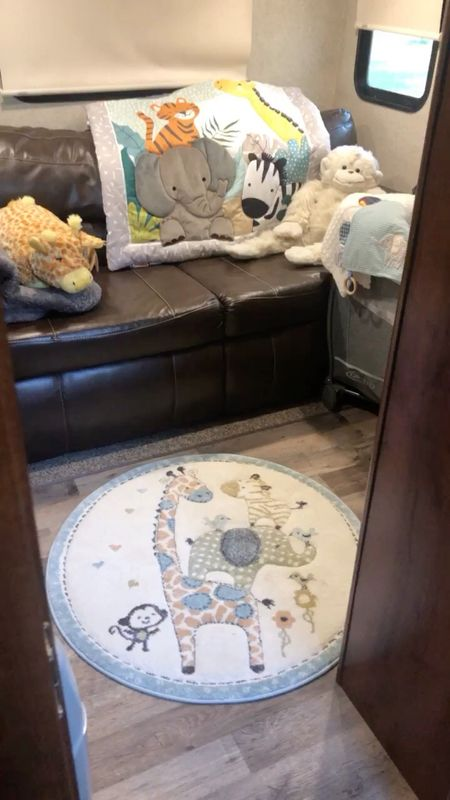 5th wheel travel trailer bunkhouse nursery decor. #babyroom #nurseryrug #packnplay #jungle #animals   #LTKbaby #LTKhome #LTKfamily