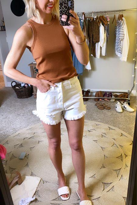 http://liketk.it/3gjPi #liketkit @liketoknow.it  Memorial Day outfit idea... White shirts + high neck tank + white slides  Add a denim jacket for a chic #LTKunder50 #LTKstyletip #LTKshoecrush layer