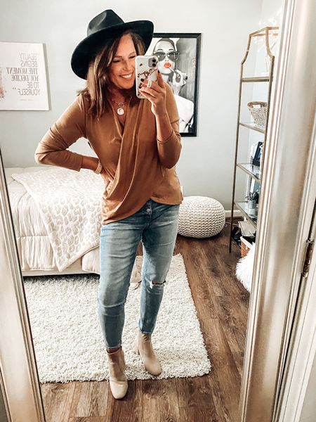 Pink Lily jeans with wrap shirt from Nordstrom styled with taupe booties and black hat. Necklace from Amazon   Fall outfits, jeans, weekend outfit, holiday outfit, thanksgiving outfit, sweater, boutique outfits, sale, fashion over 40  #LTKstyletip #LTKsalealert #LTKunder50