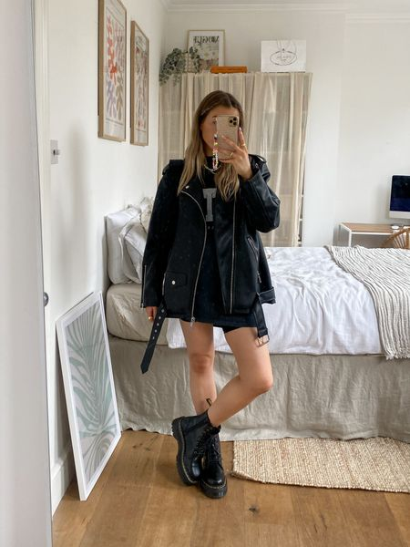 An oversized t shirt teamed with cueing shorts is such an easy to go look! I love this Missguided oversized leather jacket layered over the top for a biker chic look     #LTKeurope