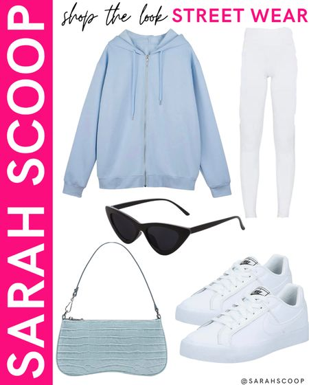 This is your chance to look like one of your favorite celebrities by buying this super cute streetwear outfit! This light blue oversized sweatshirt is styled with white leggings, nike sneakers, and retro sunglasses and purse! 💙  #oversizedsweatshirt#lightblue#white#leggings#nike#nikesneakers#blacksunglasses#retro#retrosunglasses#retropurse#lightbluepurse#amazon#amazonfashion#amazonfashionfinds#primewardrobe#trendy#college#comfortable#affordable  #LTKSeasonal #LTKunder100 #LTKstyletip