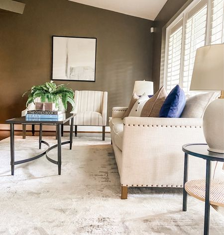 Neutral furniture to lighten up this moody living room.  Nailhead sofa, neutral couch, abstract art, living room decor, living room furniture, home decor  #LTKhome