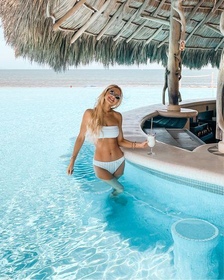 White two-piece, bandeau bikini, vacation style, white swimsuit, bikini, vacation outfit, beach outfit http://liketk.it/3etJU #liketkit @liketoknow.it #LTKswim #LTKstyletip #LTKtravel