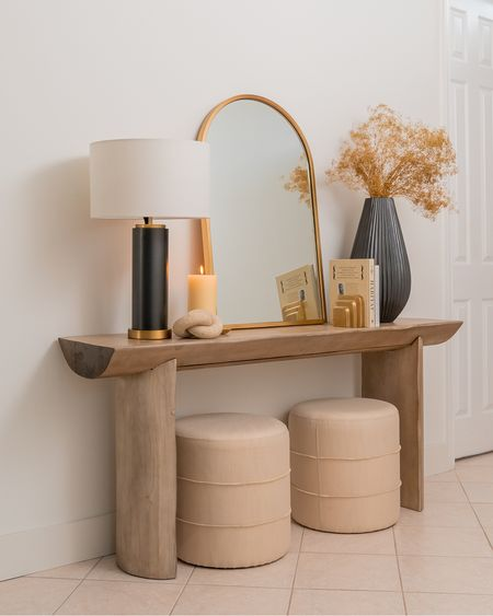 Holiday entryway decor! Loving this black and gold decor pieces, perfect for Christmas and New Years.   Wood rustic console table, target stools, entryway decor, holiday decor, black vase, black lamp, gold mirror, neutral decor, modern decor, studio mcgee, pottery barn    #LTKSeasonal #LTKhome #LTKHoliday