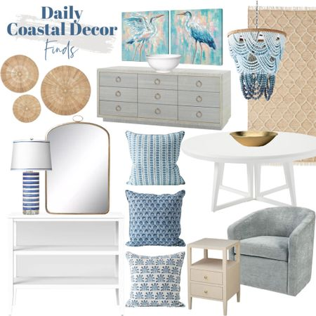 Shop my daily coastal decor finds!    http://liketk.it/3jULl #liketkit @liketoknow.it @liketoknow.it.home #LTKhome #LTKsalealert #LTKstyletip  Coastal hone decor, coastal furniture, coastal light fixture, coastal chandelier, beaded chandelier, white console table, blue lamp, blue pillow covers, neutral rug, white dining table, gold accessories, brass mirror, wood side table