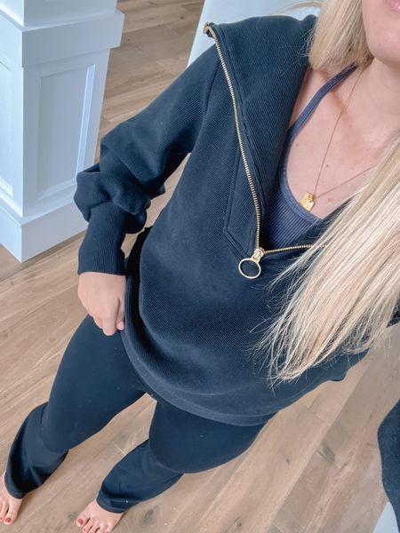 Wearing small in quarter zip and medium long in leggings!