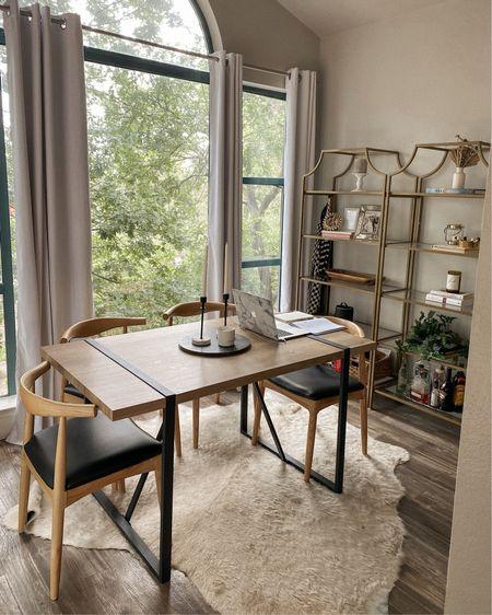 neutral dining room ! Mid century modern chairs, industrial table, black out white curtains, gold bookshelves http://liketk.it/3h8E0 @liketoknow.it #liketkit #LTKsalealert #LTKhome #LTKstyletip