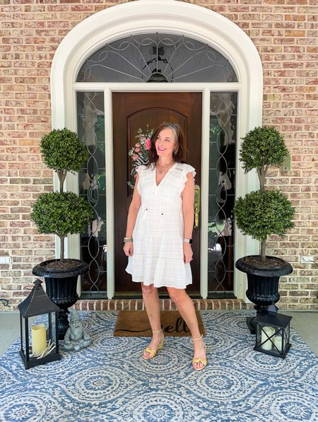 Welcome summer with this fabulous white dress from Target! Wearing a size small. Great dressed up with a wedge or down with slides. Loving our porch for spring and summer with the fabulous faux topiaries.   #LTKstyletip #LTKhome #LTKSeasonal