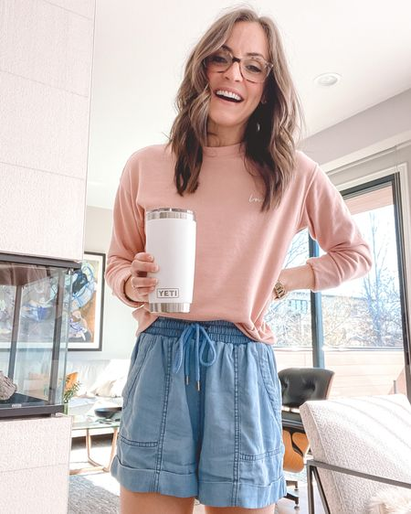"""I have been living in this $9 crewneck sweatshirt from H&M! It's the perfect sweatshirt for lounging around during quarantine and lightweight enough for spring. I love the subtle script """"love"""" on the front left chest, too. It's available in 8 colors and runs TTS. I'm wearing an XS but you could easily size up 1-2 sizes for an oversized fit.  My Yeti rambler and slippers are also linked! http://liketk.it/2Nkcu #liketkit @liketoknow.it #StayHomeWithLTK #LTKspring #LTKstyletip"""